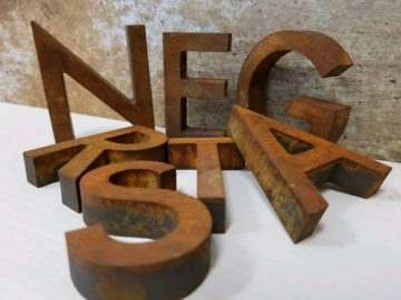Lightweight PVC letters with rusted finish.