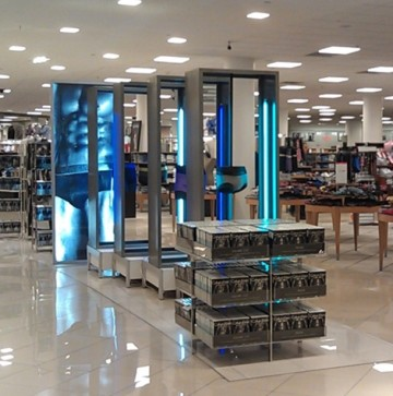 Fabricated aluminum floor displays with blue fluorescent lights