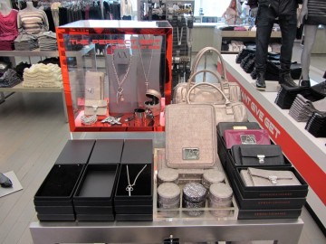 Clear acrylic display case with red mirror trim and lockable back