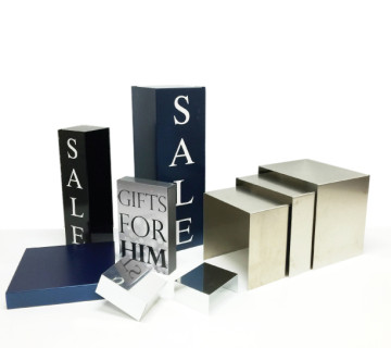 Durable magnetic risers and trays with quick change magnetic prints