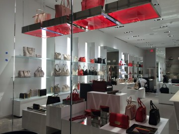 Hanging polished chrome trays with translucent red plastic and LED lights