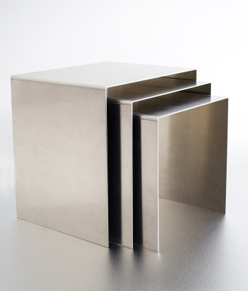 Brushed chrome metal risers