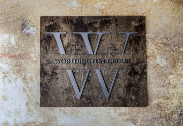 Raw steel letters and logo mounted to a wood background