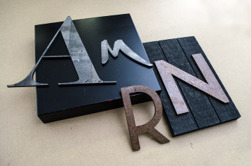 Raw Steel letters and raw steel letters with the antiqued rust finish