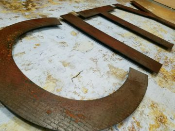 "¼"" thick antiqued steel letters"