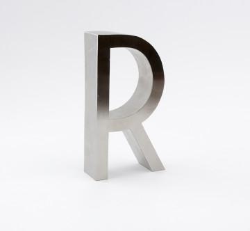 "Polished chrome metal laminate mounted to 1"" thick plastex"