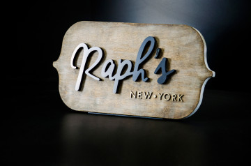Antiqued wood background with raised letters