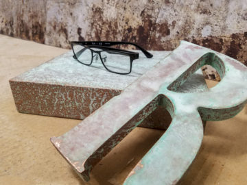 Copper patina finish on fabricated plastic riser and plastic letter
