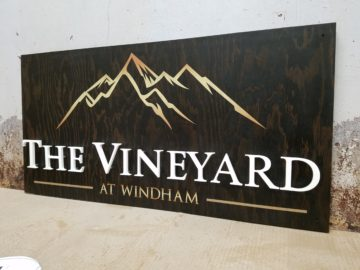 Exterior wood stained with digital print and raised acrylic letters
