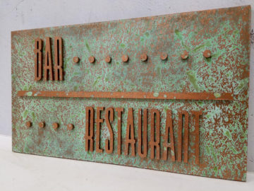 "Copper patina finish on ½"" Plastex with raised letters"
