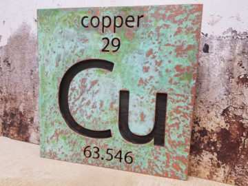 "Copper patina finish on 2"" thick MDF with engraved letters"