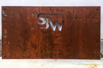 "1/8"" Steel with stencil cut letters and real rust finish"